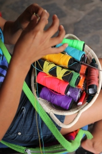 Young Panamanian woman weaving handicrafts